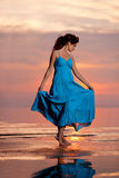 Happy Woman enjoying in Sea Sunset. Stock Images