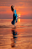 Happy Woman enjoying in Sea Sunset. Stock Photo