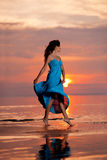 Happy Woman enjoying in Sea Sunset. Stock Photos
