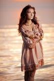 Happy Woman enjoying in Sea Sunset. Stock Image