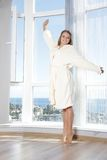 Happy woman enjoying sea view in hotel / room Royalty Free Stock Photo