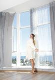 Happy woman enjoying sea view in hotel / room Stock Photography