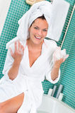 Happy woman enjoying spa treatment hotel bathroom Stock Images