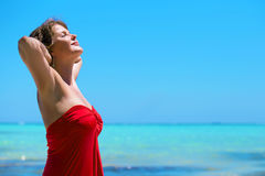 Happy woman enjoying summer by the ocean Stock Photography