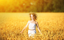 Happy woman enjoying summer outdoors in wheat royalty free stock images