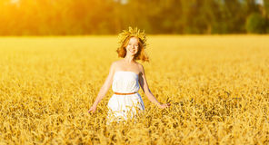 Happy woman enjoying summer outdoors in wheat Royalty Free Stock Photo