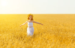 Happy woman enjoying summer outdoors in wheat stock image