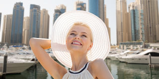 Happy woman enjoying summer over dubai city harbor Stock Photos