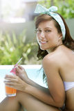 Happy woman enjoying summer by poolside Royalty Free Stock Photos
