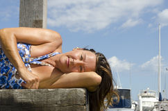 Happy Woman enjoying sunny day at Marina Royalty Free Stock Image
