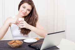 Happy woman enjoying tea and cookies Stock Images