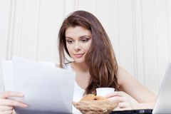 Happy woman enjoying tea and cookies Stock Image