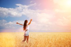 Free Happy Woman Enjoying The Life In The Field Nature Beauty, Blue Sky And Field With Golden Wheat. Outdoor Lifestyle. Freedom Concept Stock Image - 150255971
