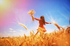 Happy Woman Enjoying The Life In The Field Nature Beauty, Blue Sky And Field With Golden Wheat. Outdoor Lifestyle. Freedom Concept Royalty Free Stock Images