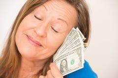 Happy woman enjoying us dollar Royalty Free Stock Photography