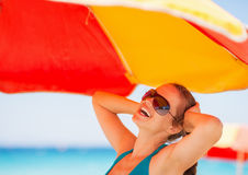 Happy woman enjoying vacation on beach Royalty Free Stock Images