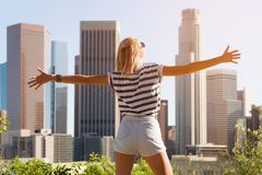 Happy woman enjoying the view Los Angeles downtown, California, USA.  royalty free stock images