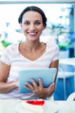 Happy woman enjoys using her tablet Royalty Free Stock Photos