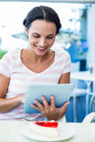 Happy woman enjoys using her tablet Royalty Free Stock Photo