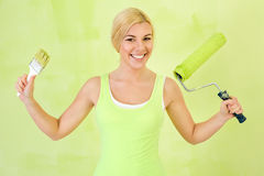 Happy woman with equipment for painting Royalty Free Stock Photos
