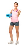 Happy Woman With Exercise Mat Gesturing Thumbs Up Stock Photography