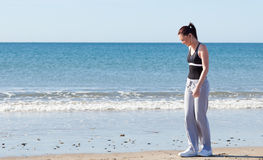 Happy woman exercising on the beach Stock Image