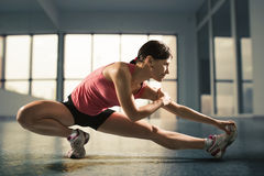 Happy woman exercising at the gym Royalty Free Stock Photo