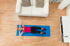Happy Woman Exercising At Home Stock Images
