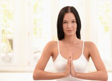 Happy woman exercising meditation Stock Images