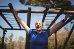 Happy woman exercising during obstacle course. In boot camp stock photos