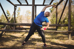 Happy woman exercising during obstacle course. In boot camp Royalty Free Stock Photo