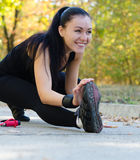 Happy woman exercising in a park Royalty Free Stock Images