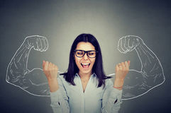 Happy woman exults pumping fists celebrates success. On gray wall background Royalty Free Stock Photography