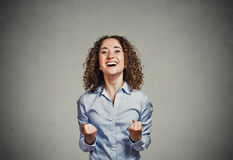 Happy woman exults pumping fists celebrates success screaming Royalty Free Stock Photo
