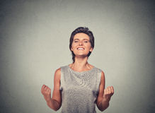 Happy woman exults pumping fists ecstatic. Celebrates success royalty free stock photography