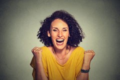 Happy woman exults pumping fists ecstatic celebrates success Stock Photos