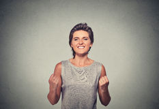 Happy woman exults pumping fists ecstatic celebrates success Royalty Free Stock Photos