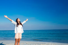 Happy woman with eyes closed at the beach. On a sunny day Stock Image