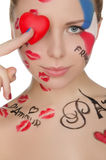 Happy woman with face art on theme of France Stock Photos