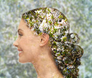 Happy woman face over blooming tree pattern Stock Photos