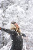 Happy Woman at Falling Snow with Open Arms stock image