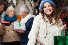 Happy Woman With Family In Christmas Store Royalty Free Stock Photo