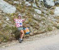 Happy Woman Fan - Tour de France 2015. Col de la Croix de Fer, France - 25 July 2015: Unidentified woman fan in a Polka Dot Jersey is very happy on the road to Stock Photography