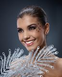 Happy woman with fancy makeup and fan Royalty Free Stock Images