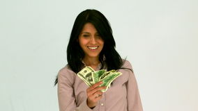 Happy woman fanning bills Stock Image