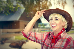 Happy woman farmer posing on ranch background Stock Images