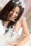 Happy woman among feathers Royalty Free Stock Photography