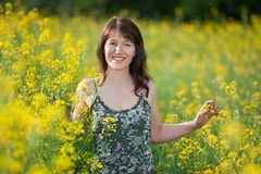 Happy woman in field Stock Images