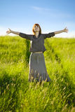 Happy woman in field Royalty Free Stock Photos
