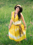 Happy Woman in Field. An image of a pretty young woman in a long dress, laughing happily outside Stock Image